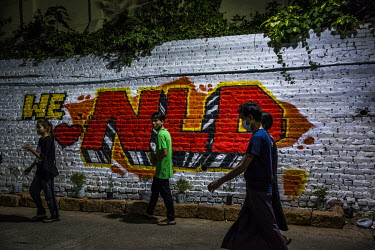 An English language graffiti art slogan that reads: 'We Love NLD' (National League for Democracy), on a wall in the city centre.