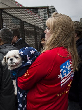 A Trump supporter with a dog on the day of Donald Trump's inauguration.