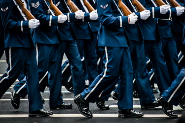 Military in ceremonial dress marching on the day of Donald Trump's inauguration.