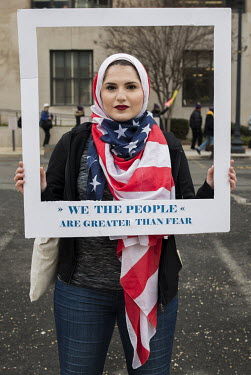 Nour Obeidallah (19), wearing a Stars and Stripes hijab, after the Shepard Fairey image (from the original photograph by Ridwan Adhami), one of the around half a million people who gathered in DC for...
