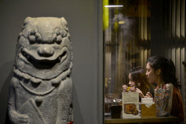 A Wing Lion God placed at the entrance of a hot pot restaurant along Jincheng's Old Street. Found almost exclusively on Kinmen, its Wind Lion God statues, scattered around the island supposedly to hel...