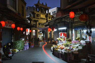 Evening street scene with ornate memorial arch honoring the virtuous wife of Ching Dynasty General Chiu Chih-jen architecture in central Jincheng, Kinmen's main population settlement.