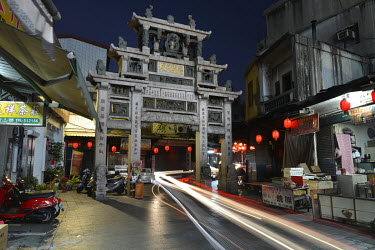 Evening street scene with ornate memorial arch honouring the virtuous wife of Ching Dynasty General Chiu Chih-jen in central Jincheng, Kinmen's main population settlement.