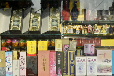 A variety of brands of Kinmen's famous Kaoliang Liquor - a spirit distilled from sorghum and one of the major export earners for the island - displayed in a store window in Jincheng, Kinmen's main tow...