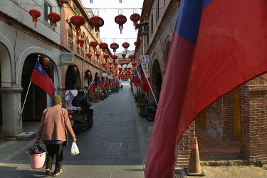 General view of pedestrians and Taiwan's national flags along the Old Street in Jincheng, Kinmen's main settlement. The street is a major tourist hot spot and also a place to find stores selling Islan...