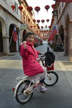 A girl, resident of Kinmen, rides her bike along Old Street in Jincheng, Kinmen's main settlement.