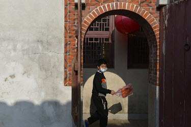 A young student on Kinmen passes down an ornate arched alleyway in downtown Jincheng, the main settlement on the island.