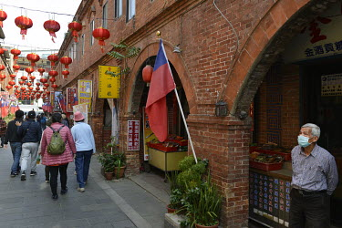 Tourists from mainland Taiwan visiting the Old Street in Jincheng, Kinmen's main settlement. The street is a major tourist hot spot and also a place to find stores selling Island specialities.