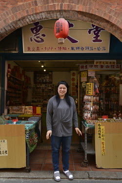 Ms Huang, Kinmen resident and owner of a souvenir store located on the Old Street in Jincheng, Kinmen's main settlement stands in front of her shop.