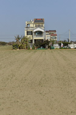 A house surrounded by agricultural land on Kinmen's main island. Following many years of economic neglect and decline, the property market on Kinmen is starting to look up with some people from mainla...