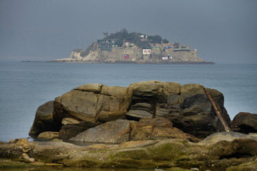 Shiyu Islet, a forward observation post controlled by the Taiwanese military, seen from Xiao (Little) Kinmen Island, just a mile or two from the Chinese Mainland.   Following the retreat of Chiang K...