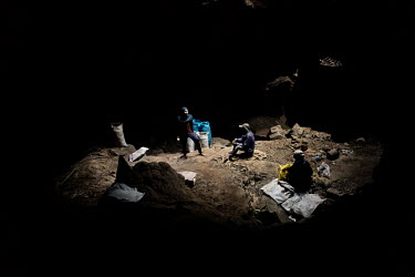 Villagers rest while they collect bat droppings, which they sell as fertiliser, in the Khao Chong Pran Cave.  A team of researchers consisting of scientists, ecologists, and officers from Thailand's N...