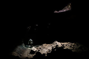 Villagers collect bat droppings, which they sell as fertiliser, in the Khao Chong Pran Cave.  A team of researchers consisting of scientists, ecologists, and officers from Thailand's National Park Dep...