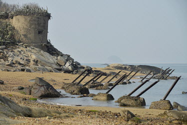 Beach defences on Xiao (Little) Kinmen Island, just a mile or two from the Chinese Mainland.   Following the retreat of Chiang Kai-shek's nationalist Kuomintang (KMT) forces to Taiwan (Formosa) at t...