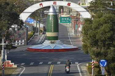 The August 23 Artillery Battle Victory Monument (with the Victory Gate behind) in the centre of a roundabout on Xiao (Little) Kinmen Island commemorating the Second Taiwan Strait Crisis (23 August â�...