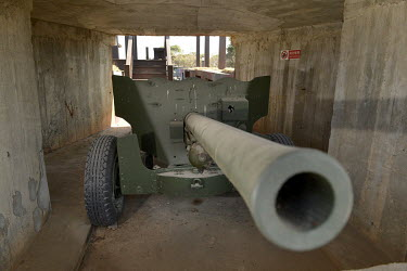 An old artillery piece kept on display in a bunker on Xiao (Little) Kinmen Island, just a mile or two from the Chinese mainland.   Following the retreat of Chiang Kai-shek's nationalist Kuomintang (...
