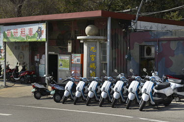 A row of electric scooters available for rent near the ferry terminal on Xiao (Little) Kinmen Island, just a mile or two from the Chinese mainland.   Following the retreat of Chiang Kai-shek's natio...