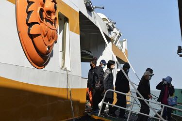 Passengers disembark from the ferry that plies the short route between Kinmen's main island and Xiao (Little) Kinmen Island, just a mile or two from the Chinese mainland.   Following the retreat of...
