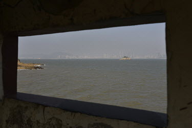 The view from a formerly fully-manned coastal defensive post on Xiao (Little) Kinmen Island towards Xiamen on the Chinese mainland.  Following the retreat of Chiang Kai-shek's nationalist Kuomintang (...