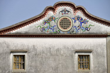 Ornate ceramic work on the facade of a traditional residence in the small village of Husia.