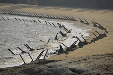 Angled metal spikes, positioned to repel amphibious invasion, line a beach on Xiao (Little) Kinmen Island, just a mile or two from the Chinese mainland.   Following the retreat of Chiang Kai-shek's na...