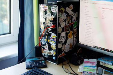 Stickers on the computer of Kasia, 19, an architecture student, who is taking lessons at home. All lessons have been online since the pandemic began in March 2020.  'I have a friend who, every time he...