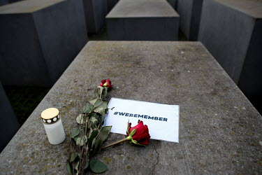 A red rose and sign '#weremember' on a stele of the Holocaust Memorial on Holocaust Memorial Day 2021.