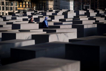 A couple walk among the stele of the Holocaust Memorial on Holocaust Memorial Day 2021.