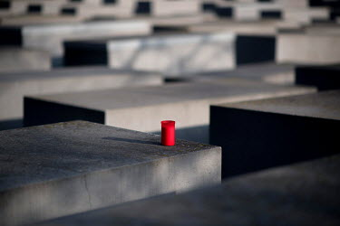 A red candle on a stele of the Holocaust Memorial on Holocaust Memorial Day 2021.