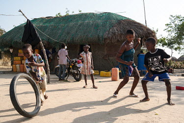 Children dancing to music from a wireless speaker in the small village of Midie on the edge of the 'Yomo', the area traditionally held to be the spiritual heart of the salt-rich Songor Lagoon.