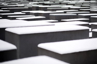 Snow covers the Stele of the Holocaust Memorial.