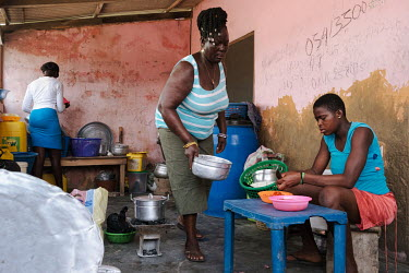 Mary Akuteye with her daughter Sophia (14, left) and niece Bernice (16) at their home in the village of Bonneykope on the banks of the salt-rich Songor Lagoon. Unable to make a living from salt winnin...