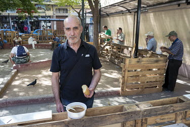 Takis (62), a former employee at a Carrefour supermarket, eating soup at the food distribution point of the City of Athens Homeless Foundation. The foundation provides 1200 meals to destitute and home...