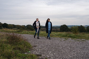 Social workers Ipek Turkekole (right) and her friend Vanessa Teyen walking on the outskirts of Bielefeld. Turkekole suffers from sickle cell disease and is treated with a routine of regular exchange b...