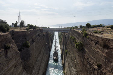 A sail ship passes through the Corinth Canal that connects the Gulf of Corinth with the Saronic Gulf in the Aegean Sea.