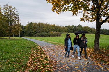 The Turkekole sisters, Ipek (left), Yasemin and Aylin take a walk in a park. Ipek and Aylin were born with sickle cell disease. Aylin was cured though the transplantation of stem cells donated by Yase...