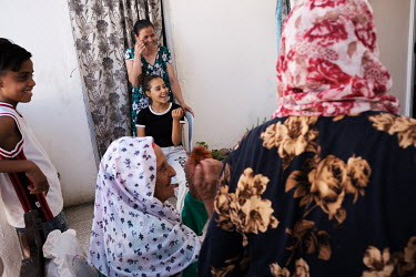Rihem Jelassi (seated at centre), 19, at her grandmother's home in a suburb of Tunis. Rihem suffers from sickle cell beta-plus thalasaemia which she is able to manage with medication and diet and life...