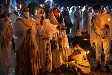 Pilgrims burn candles during a night time vigil during Timkat, celebrating the baptism of Jesus and the Orthodox Epiphany. The official slogan for the 2021 celebrations was 'Ethiopia's Rebirth at Gond...