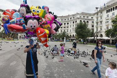 Women selling novelty balloons and bird seed for the pigeons in Aristotelous (Aristotle) Square.