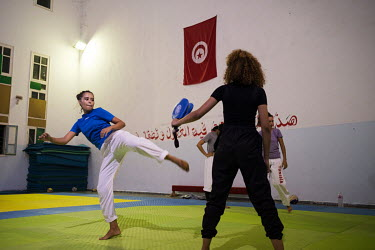 Rihem Jelassi, 19 (left), and her friend Ryhab Marwani, 18, during a taekwondo class. Rihem suffers from sickle cell beta-plus thalasaemia which she is able to manage with medication and diet and life...
