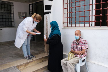 Dr. Meriem Achour, a haematologist, pausing to answer a woman's question at the Aziza Othmana Hospital where she works in Tunis. Founded in 1662, the hospital is the country's oldest and is the main h...