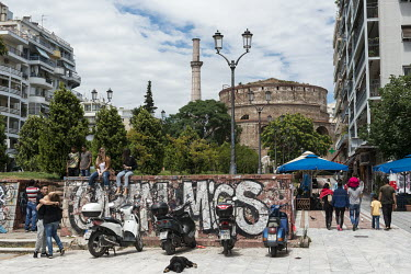People relax near the Rotunda, also known as the Church of Agios Georgios or the Rotunda of St. George.