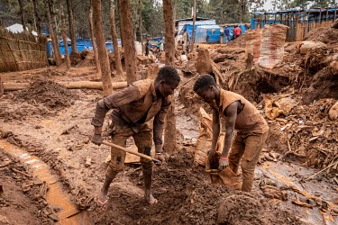 Children working on the surface at an informal gold mine.