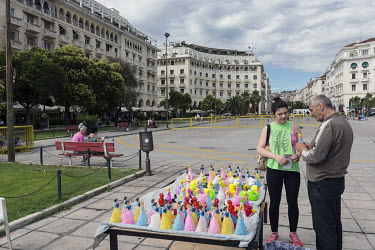 A man selling novelty toys figures in Aristotelous (Aristotle) Square.