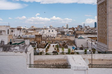A view over rooftops of the medina (old town) and city beyond near the minaret of the Zitouna mosque (at right).