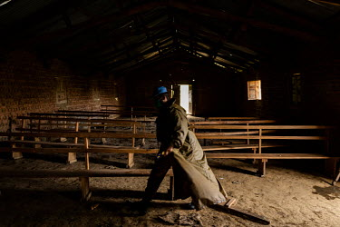 A Pakistani MONUSCO peacekeeping soldier walks through the church in the abandoned village of Monyi on the Haut Plateau. The village lies in a remote area about 15 km north-east of Minembwe. It is onl...