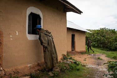 A Pakistani MONUSCO peacekeeping soldier looks into the church in the abandoned village of Monyi on the Haut Plateau. The village lies in a remote area about 15 km north-east of Minembwe. It is only a...