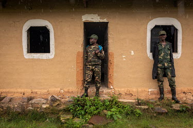 Congoless soldiers, on patrol with Pakistani MONUSCO peacekeepers, outside the church in the abandoned village of Monyi on the Haut Plateau. The village lies in a remote area about 15 km north-east of...