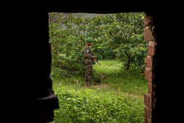 A Congoless soldier, on patrol with Pakistani MONUSCO peacekeepers, outside the church in the abandoned village of Monyi on the Haut Plateau. The village lies in a remote area about 15 km north-east o...