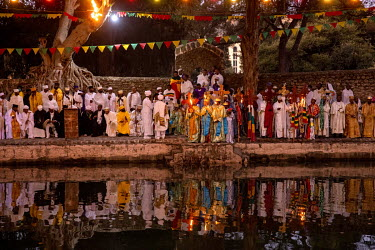 Pilgrims gather around the Fasiladas Baths during Timkat, celebrating the baptism of Jesus and the Orthodox Epiphany. Once the water is blessed, the pilgrims jump in to purify themselves. The official...